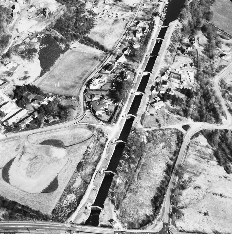 Oblique aerial view showing Neptune's Staircase, Banavie Swing Bridge and Banavie Railway Swing Bridge