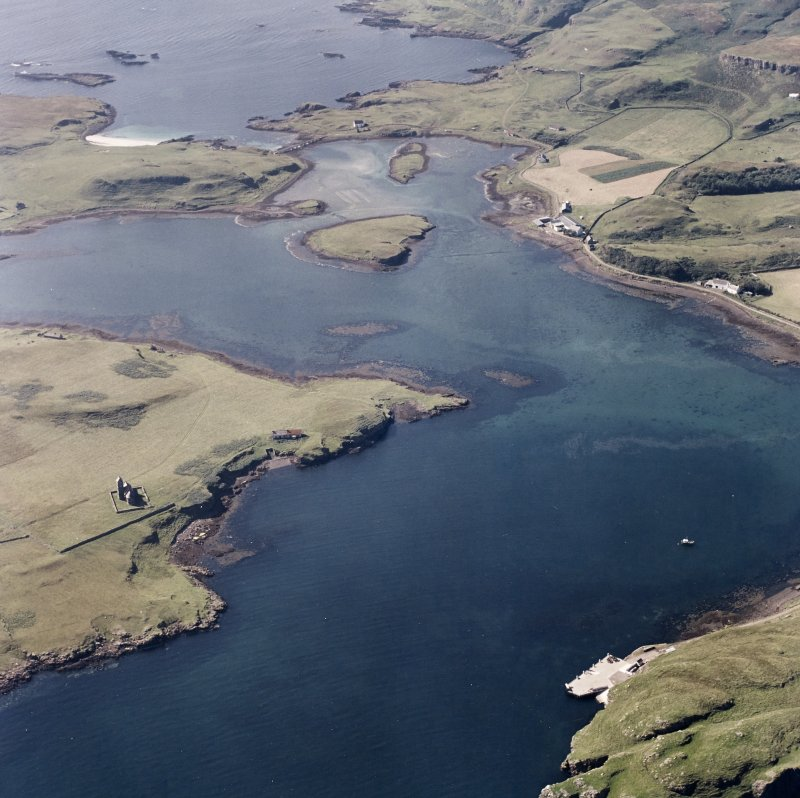 Canna and Sanday. Aerial view of Roman Catholic Church of St Edward the Confessor and Canna Harbour, pier with nearby sites, buildings and monuments at Eilean a' Bhaird, Eilean Gille Mhartein, Changeh ...