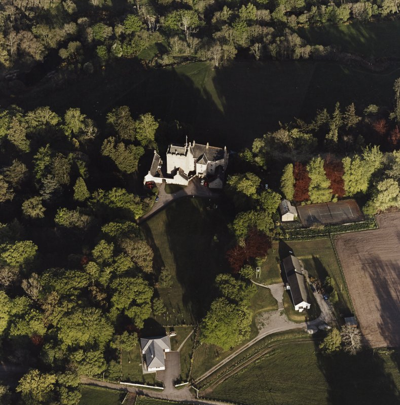 Oblique aerial view of Kilravock Castle and dovecot, taken from the NW.