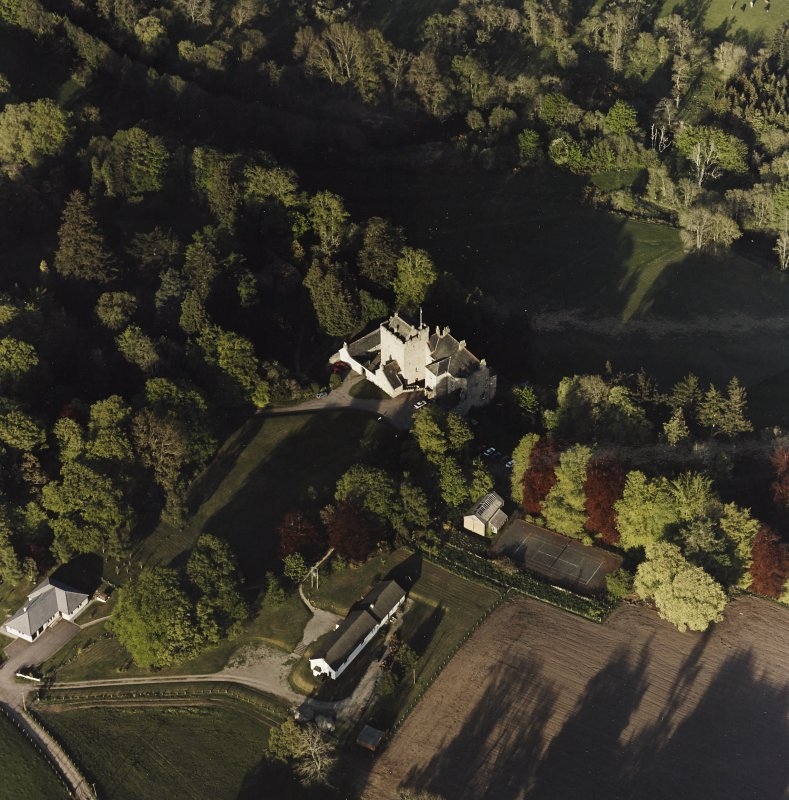 Oblique aerial view of Kilravock Castle and dovecot, taken from the W.