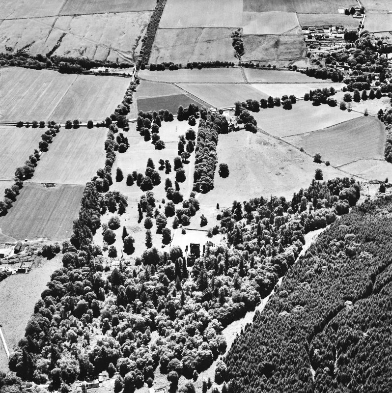 Castle Leod. Oblique aerial view, taken from the NW, showing the tower-house and a possible golf course in the centre of the photograph.