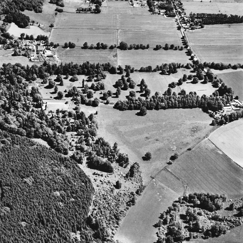 Castle Leod. Oblique aerial view, taken from the SW, showing the tower-house, a possible golf course and the gate lodge in the centre of the photograph.