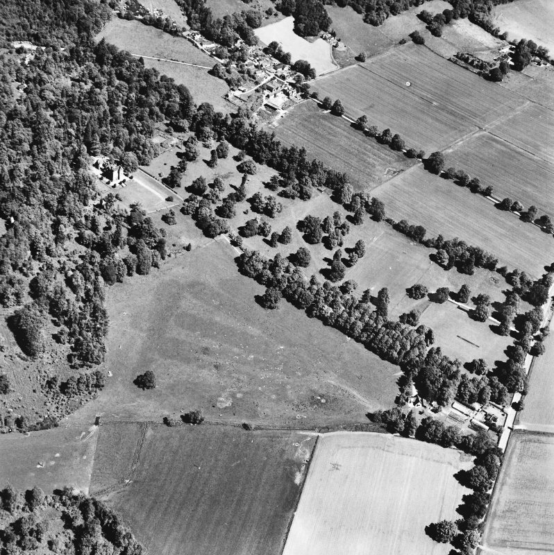 Castle Leod. Oblique aerial view, taken from the SW, showing the tower-house, a possible golf course and the gate lodge.