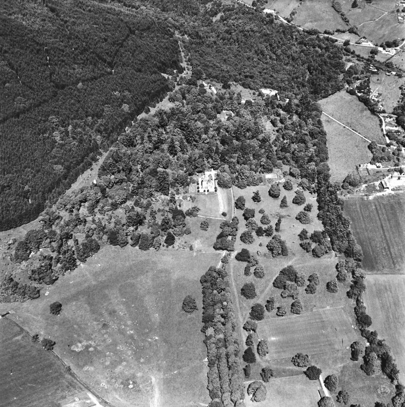 Castle Leod. Oblique aerial view, taken from the SE, centred on the tower-house. A possible golf course is visible in the bottom left-hand corner of the photograph.