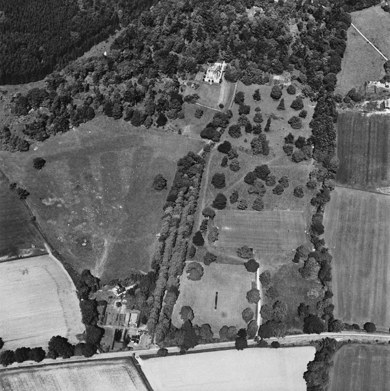 Castle Leod. Oblique aerial view, taken from the SE, showing the tower-house, a possible golf course and the gate lodge.