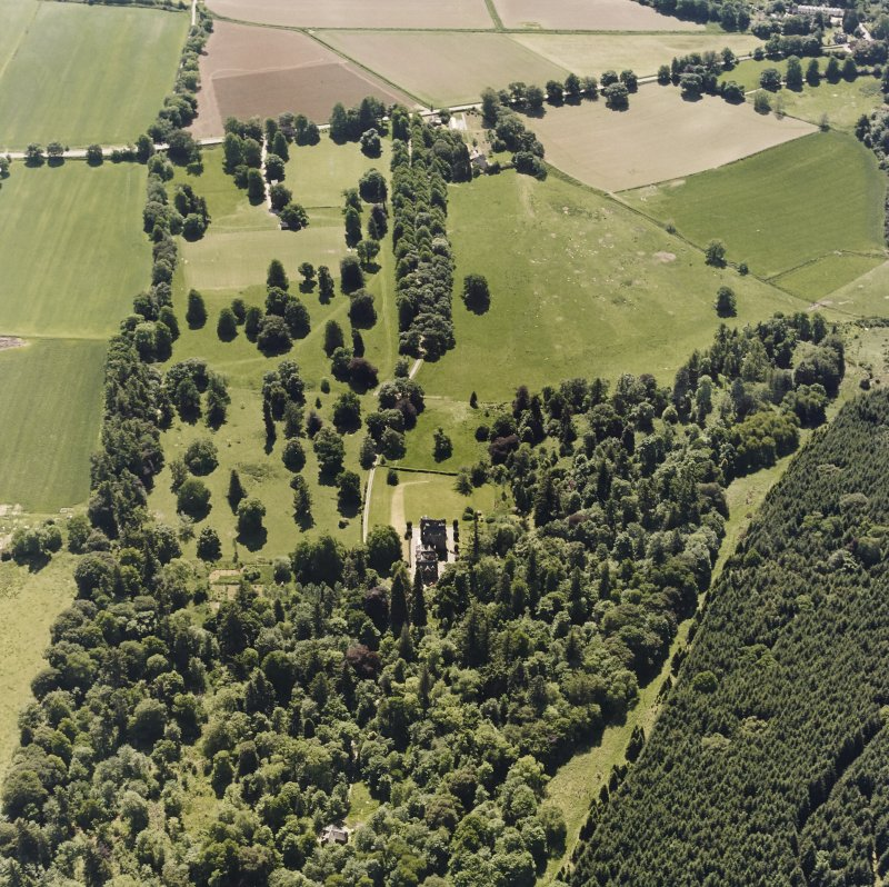 Castle Leod. Oblique aerial view, taken from the NW, showing the tower-house and a possible golf course.
