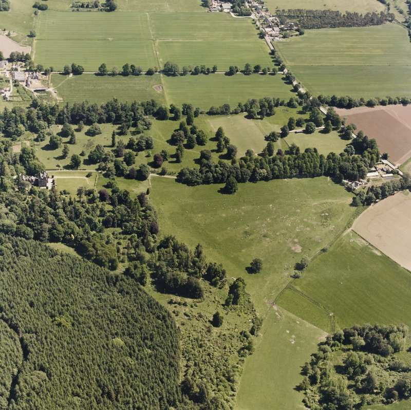 Castle Leod. Oblique aerial view, taken from the SW, showing the tower-house and a possible golf course.