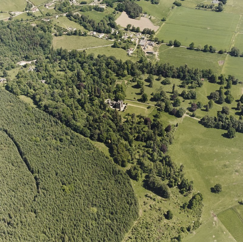 Castle Leod. Oblique aerial view, taken from the SW, centred on the tower-house. A possible golf course is visible in the bottom right-hand corner of the photograph.