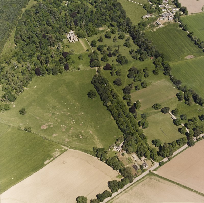 Castle Leod. Oblique aerial view, taken from the S, showing the tower-house, a possible golf course and the gate lodge.
