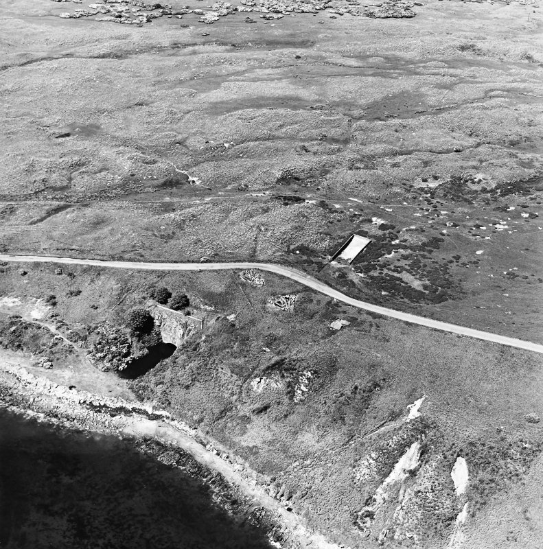 Aerial view of Nigg Second World War coast battery and accommodation camp from the SE.  The two partly demolished gun-emplacements are visible. One of the gun-emplacements has been built into the remains of Dunskeath Castle.