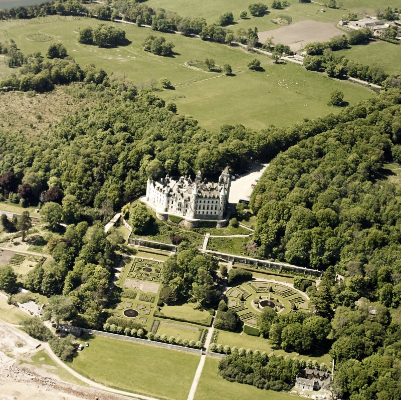 Aerial view of Dunrobin Castle, walled garden and formal gardens, taken from the NE.