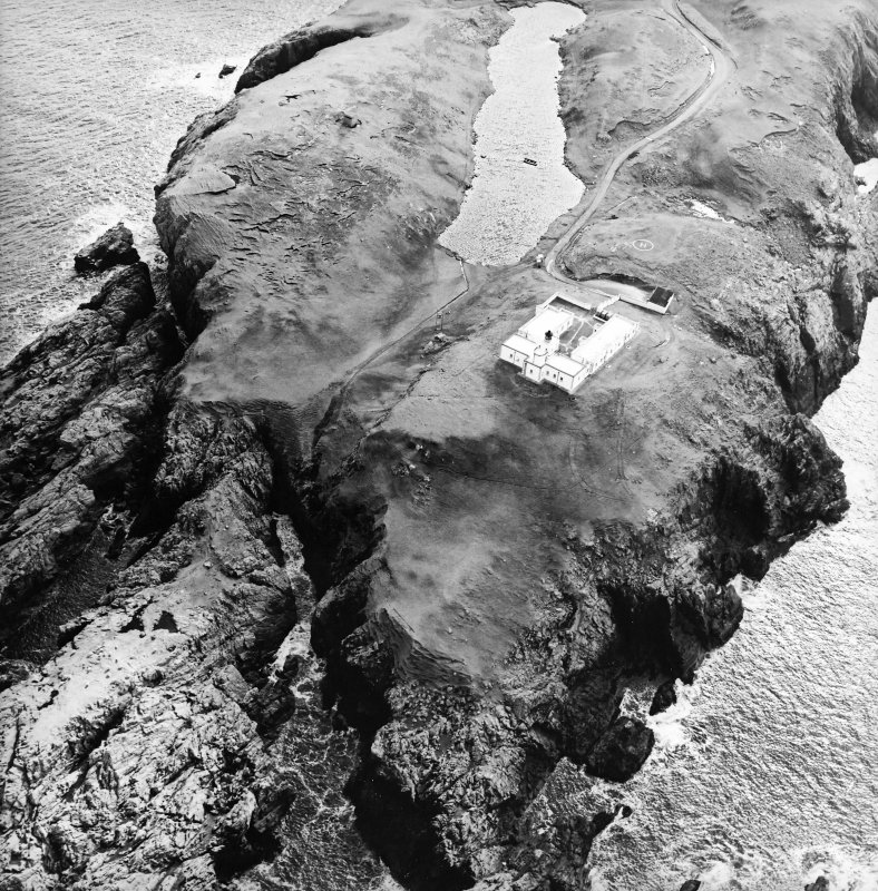 Oblique aerial view centred on the lighthouse, taken from the NW.