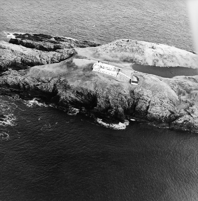 Oblique aerial view centred on the lighthouse, taken from the W.