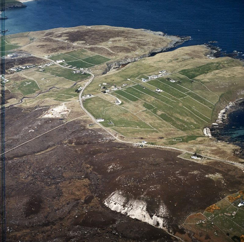 Oblique aerial view centred on the crofting townships with the remains of the radar station adjacent, taken from the SE.