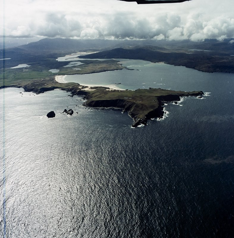 General oblique aerial view looking across the remains of the radar station towards the Kyle of Durness, taken from the NE.