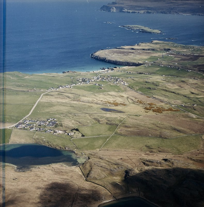 General oblique aerial view looking across the village towards the crofting township and radar station, taken from the W.
