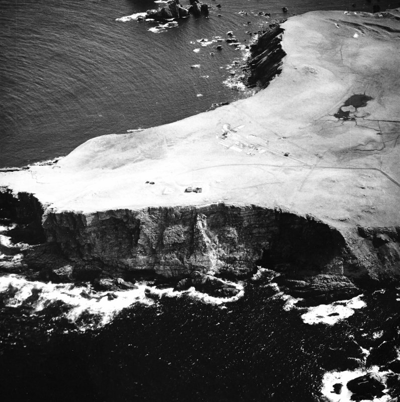 Oblique aerial view centred on the remains of the radar station, taken from the WNW.