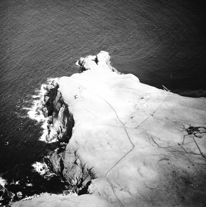 Oblique aerial view centred on the remains of the radar station, taken from the SW.