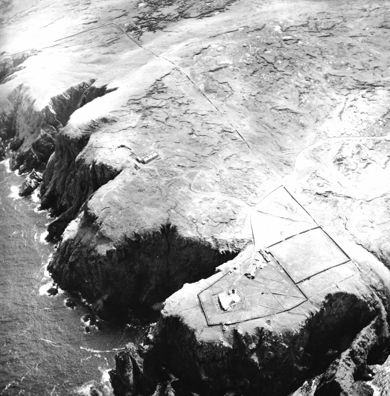Oblique aerial view centred on the lighthouse, keepers' cottages, cottages and support buildings with the radar station adjacent, taken from the N.