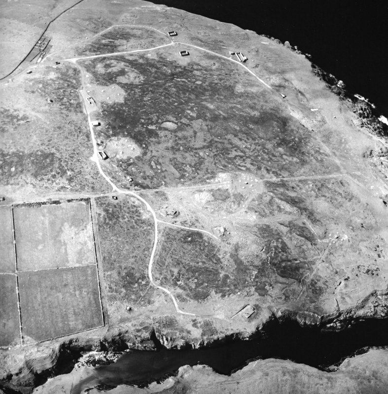 Oblique aerial view centred on the remains of the radar station, taken from the ESE.