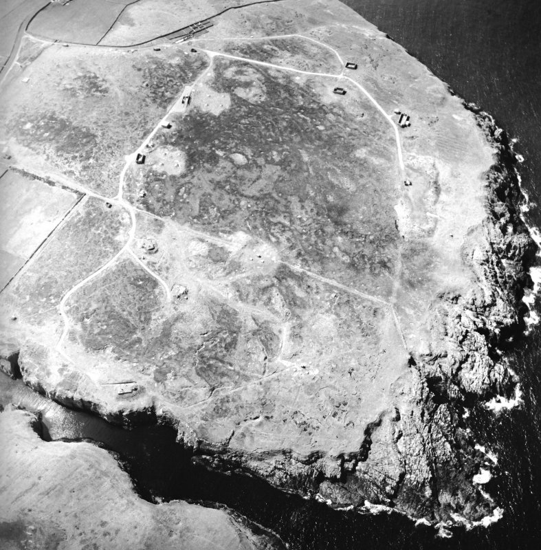 Oblique aerial view centred on the remains of the radar station, taken from the E.