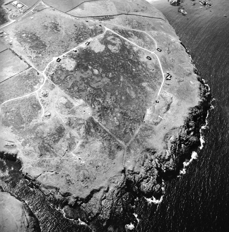 Oblique aerial view centred on the remains of the radar station, taken from the ENE.