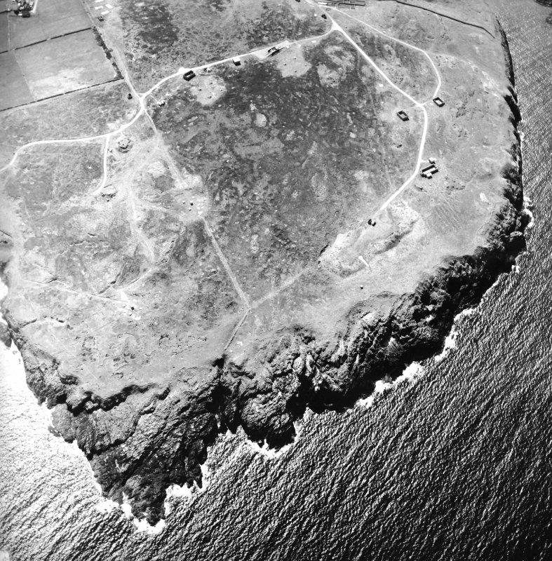 Oblique aerial view centred on the remains of the radar station, taken from the NE.