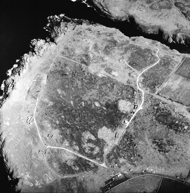 Oblique aerial view centred on the remains of the radar station, taken from the W.