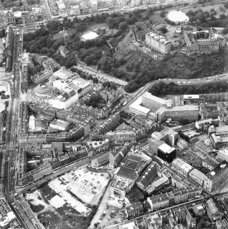 Oblique aerial view, showing Edinburgh Castle, Lothian Road and the Usher Hall.