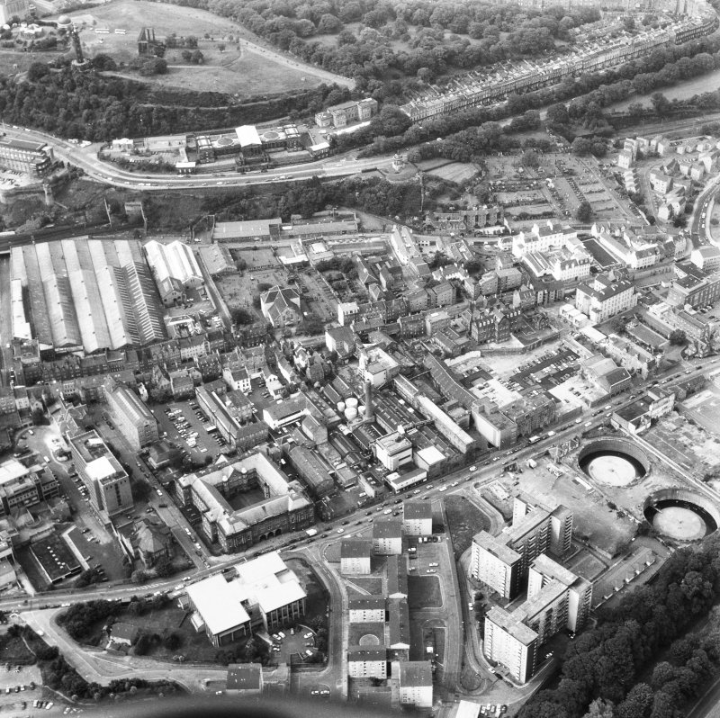 Aerial view showing Holyrood Road at bottom of photograph, New Street at left, Calton Hill at top and Canongate heading to right