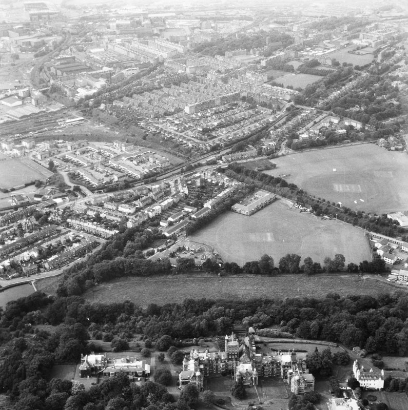 Oblique aerial view centred on Craig House, Old Craig House and Queen's Craig at bottom of photograph, and part of Craiglockhart area