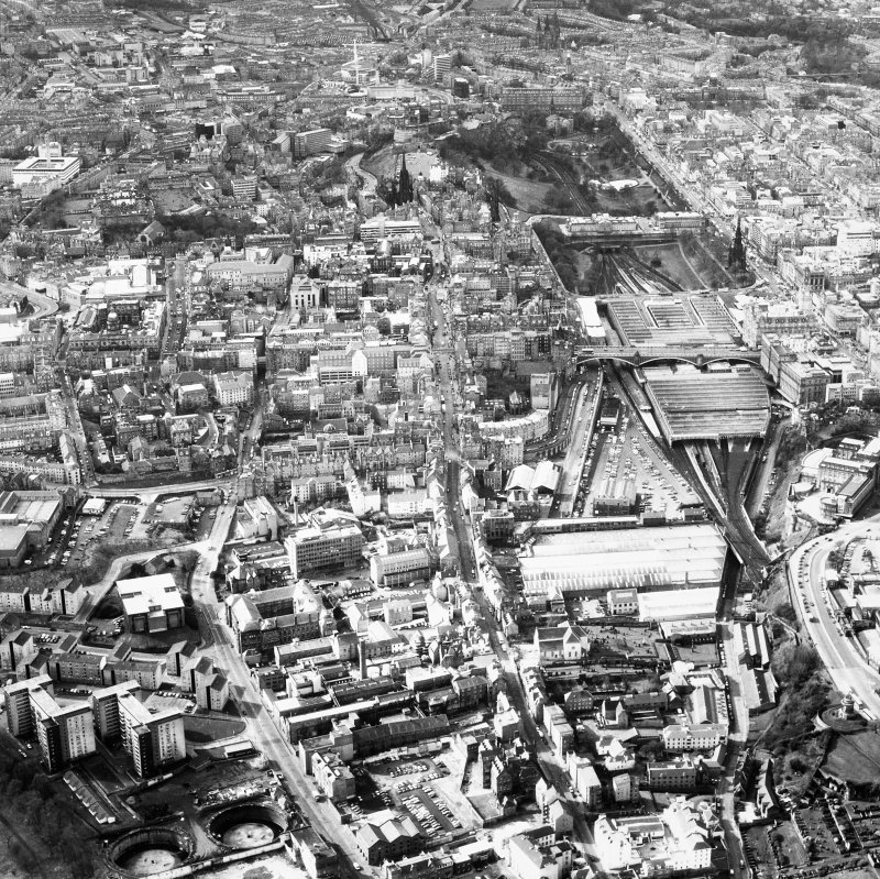 Aerial view showing Canongate towards bottom of photograph, Old College to left, Castle at top and Princes street to right