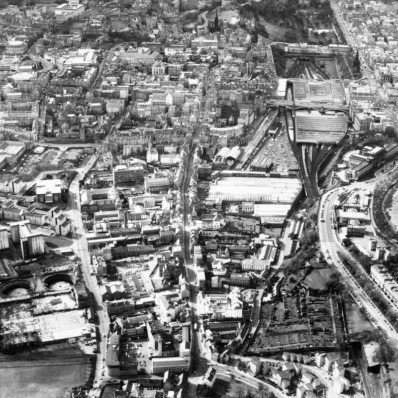 Aerial view showing Royal Mile running top to bottom of photograph, Pleasance to left and Princes Street to right