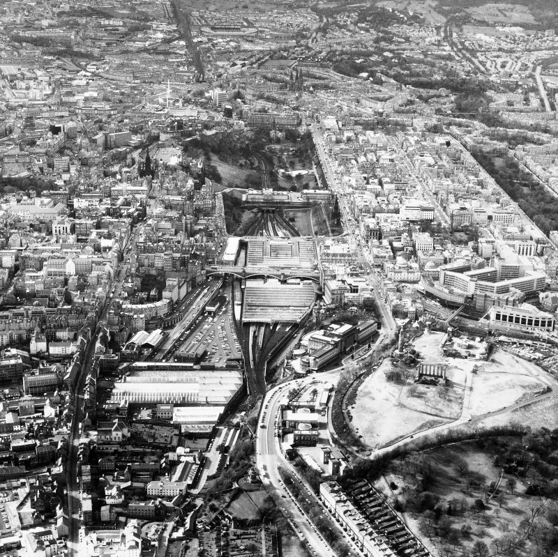 Aerial view showing Canongate and Calton Hill at bottom of photograph, Greyfriars Churchyard to left, Murrayfield Stadium at top and New Town to right