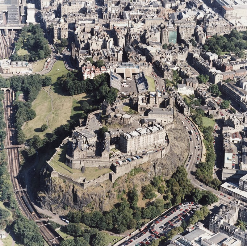 Oblique aerial view of Edinburgh Castle, Tolbooth St. John's Church, and The National Gallery.
