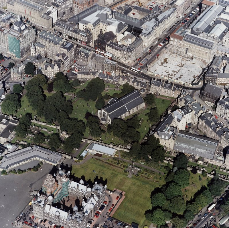 Edinburgh, oblique aerial view, taken from the SSW, centred on Candlemaker Row, Greyfriars Church and burial-ground.