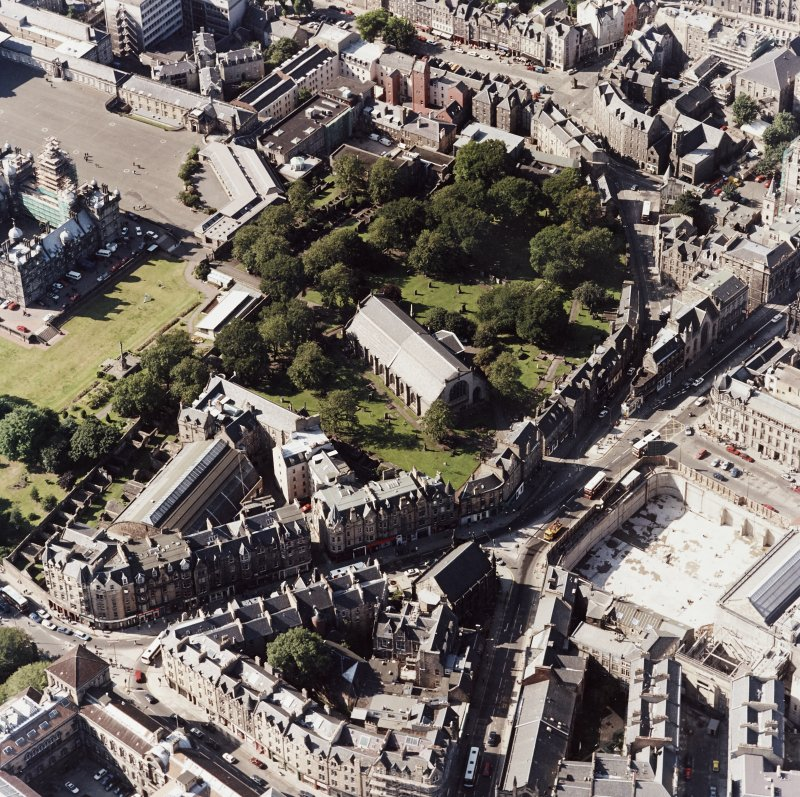 Edinburgh, oblique aerial view, taken from the SE, centred on Candlemaker Row, Greyfriars Church and burial-ground.