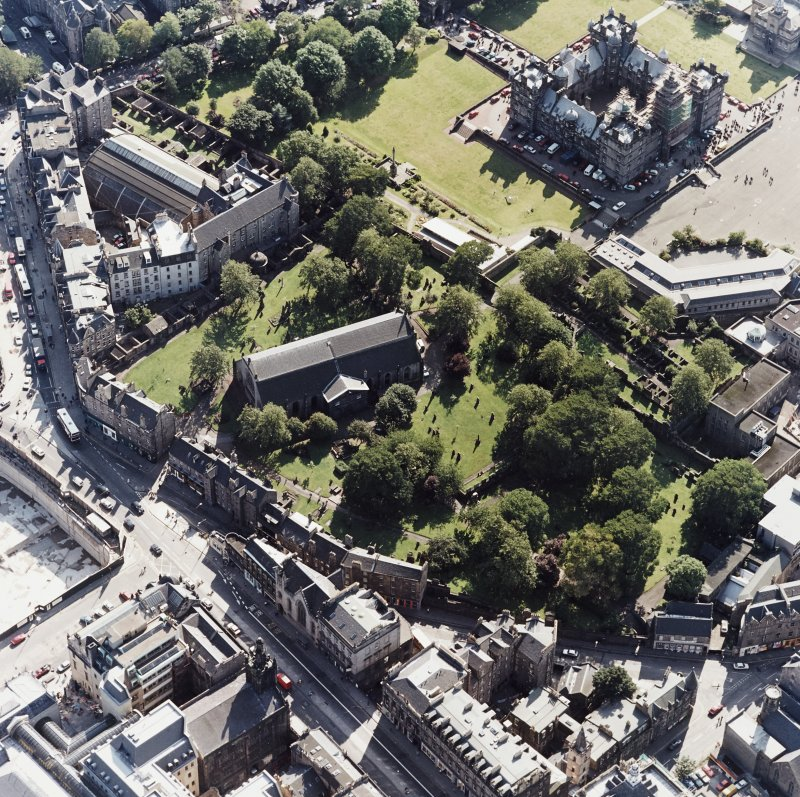 Edinburgh, oblique aerial view, taken from the NNE, centred on Candlemaker Row, Greyfriars Church and burial-ground.