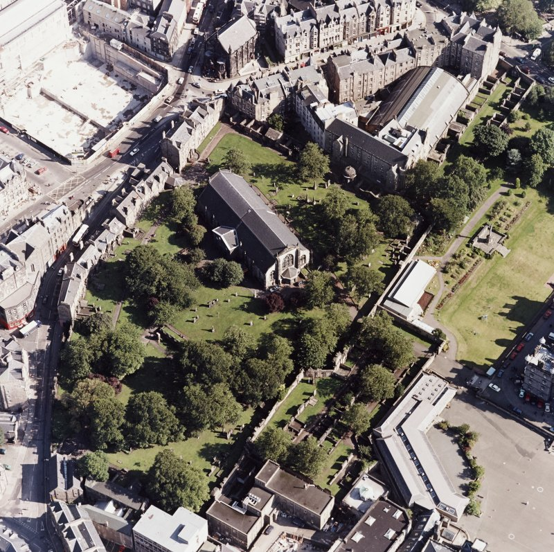 Edinburgh, oblique aerial view, taken from the WNW, centred on Candlemaker Row, Greyfriars Church and burial-ground.