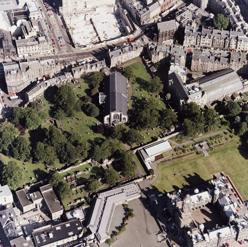 Edinburgh, oblique aerial view, taken from the W, centred on Candlemaker Row, Greyfriars Church and burial-ground.