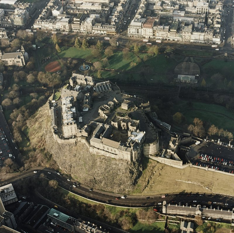 Oblique aerial view of the Edinburgh Castle centred on the castle, taken from the N.
