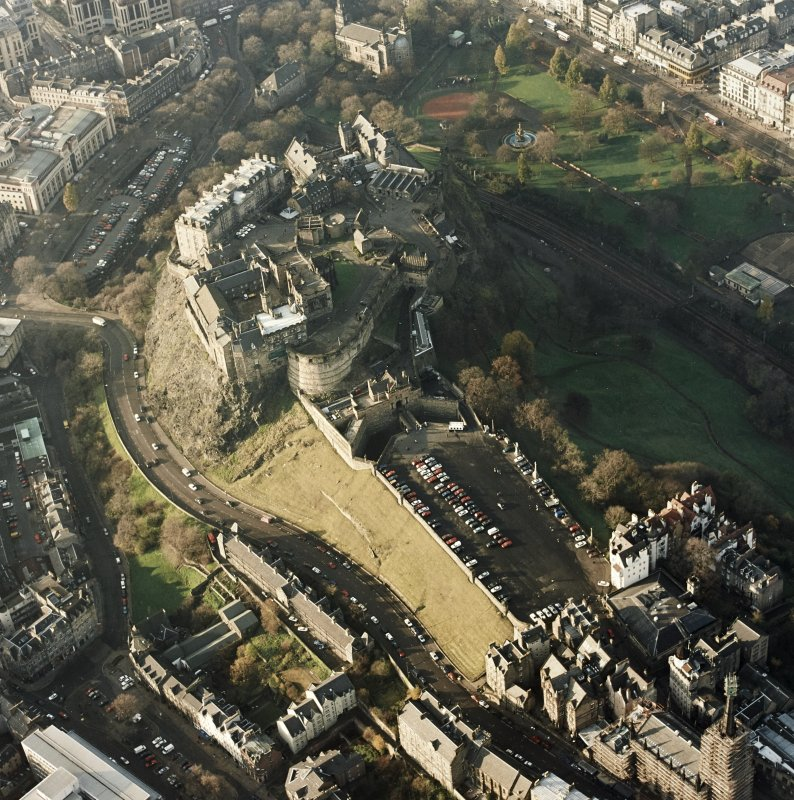 Oblique aerial view of the Edinburgh Castle centred on the castle, taken from the E.