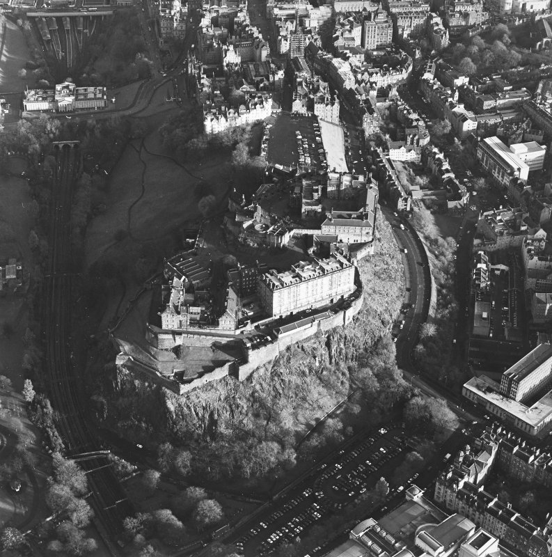 Oblique aerial view of the Edinburgh Castle centred on the castle, taken from the W.