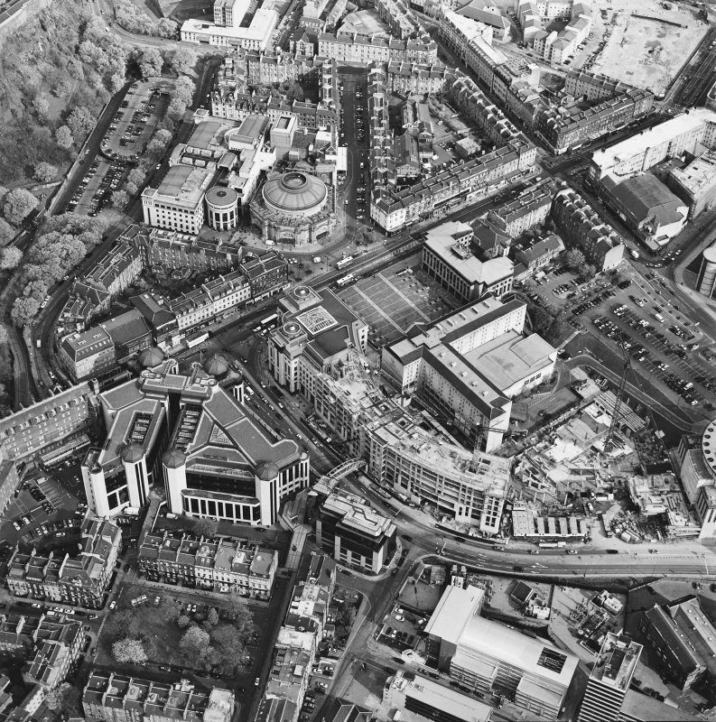 Oblique aerial view of Edinburgh centred on the Clydesdale Bank Plaza and construction of Exchange Crescent, taken from the WNW.