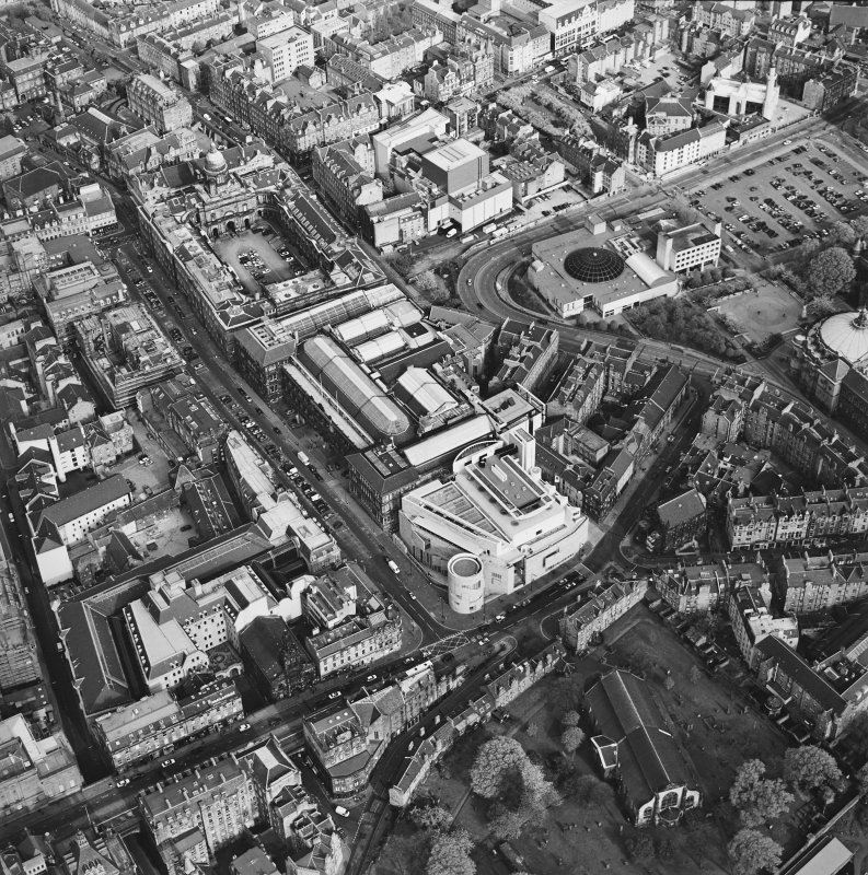 Oblique aerial view of Edinburgh centred on the Royal Museum of Scotland, taken from the NW.