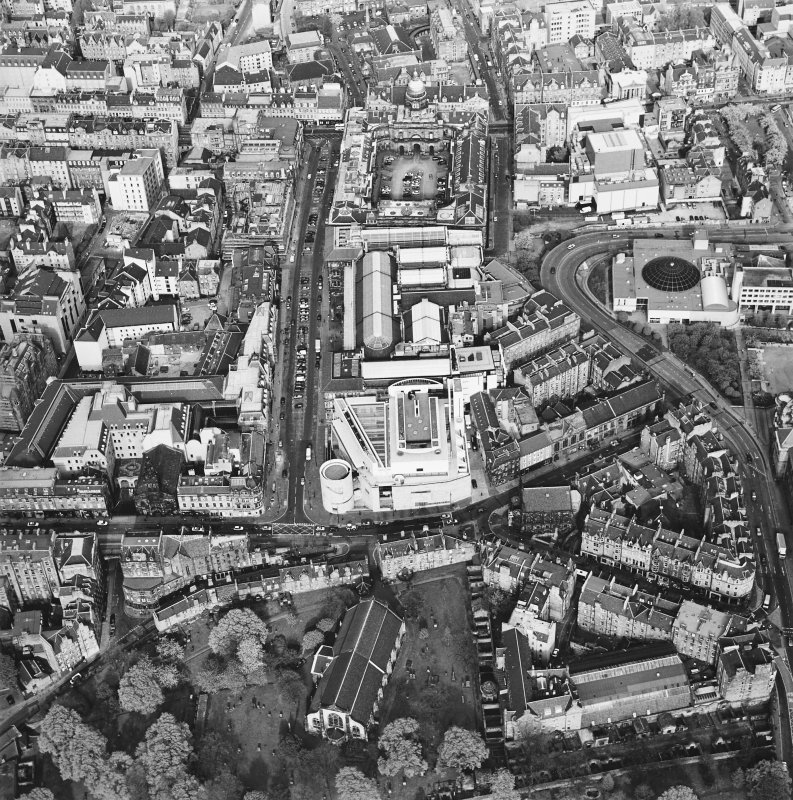Oblique aerial view of Edinburgh centred on the Museum of Scotland, taken from the WSW.