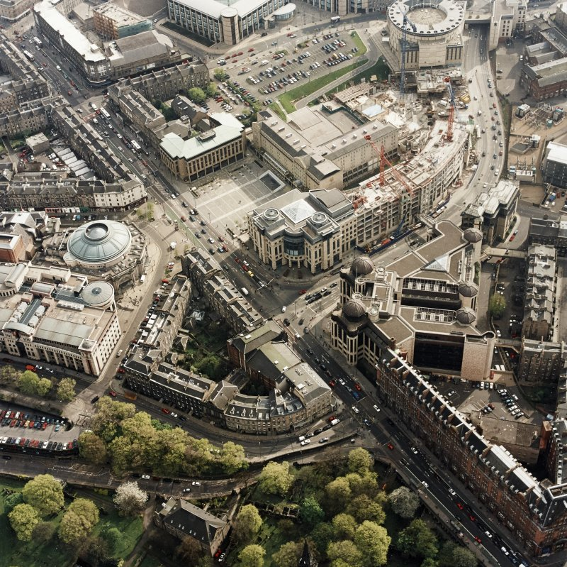 Oblique aerial view of Edinburgh centred on the Clydesdale Bank Plaza, Lothian Road, with the construction of Exchange Crescent adjacent, taken from the NE.