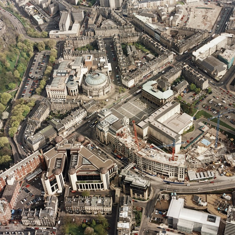 Oblique aerial view of Edinburgh centred on the construction of Exchange Crescent with the construction of the Sheraton Grand Spa adjacent, taken from the NW.