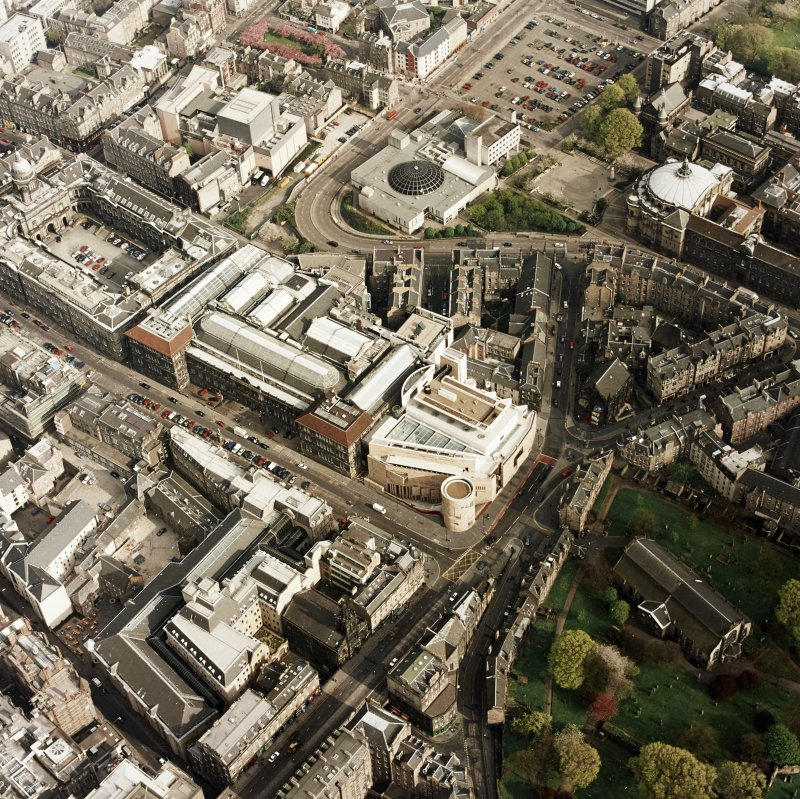 Oblique aerial view of Edinburgh centred on the Museum of Scotland, taken from the NW.