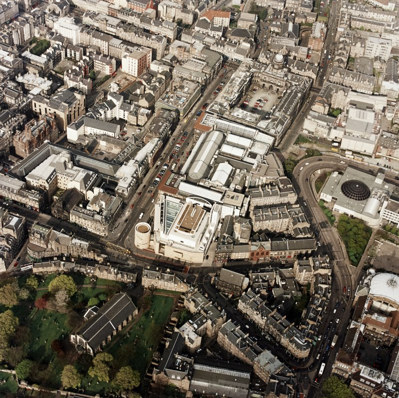 Oblique aerial view of Edinburgh centred on the Museum of Scotland, taken from the SW.